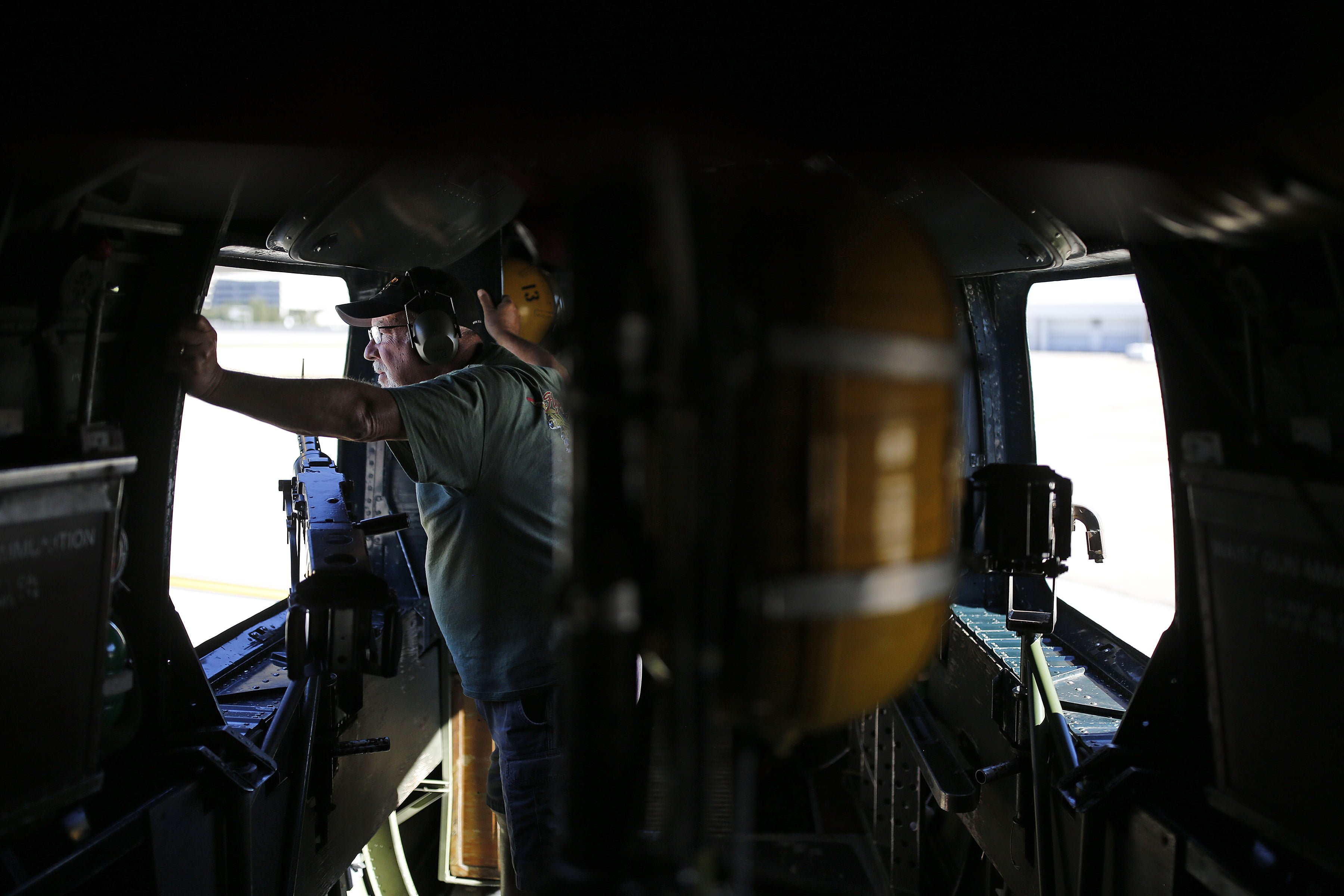 Flight crew volunteer Mike Macon, of Burlington, NC, looks out the rear of the plane as the world's only flying B-24J Liberator taxis for takeoff at Raleigh-Durham International Airport during the Wings of Freedom Tour, October 19, 2017. Hosted by the Collings Foundation, Wings of Freedom visits more than 100 cities a year to show off working pieces of American war history as well as to educate people about the veterans of WWII. The tour will be in Burlington, NC until 12 pm on Oct. 25 and then move to Statesville, NC through Oct. 27. (Eamon Queeney / North State Journal)