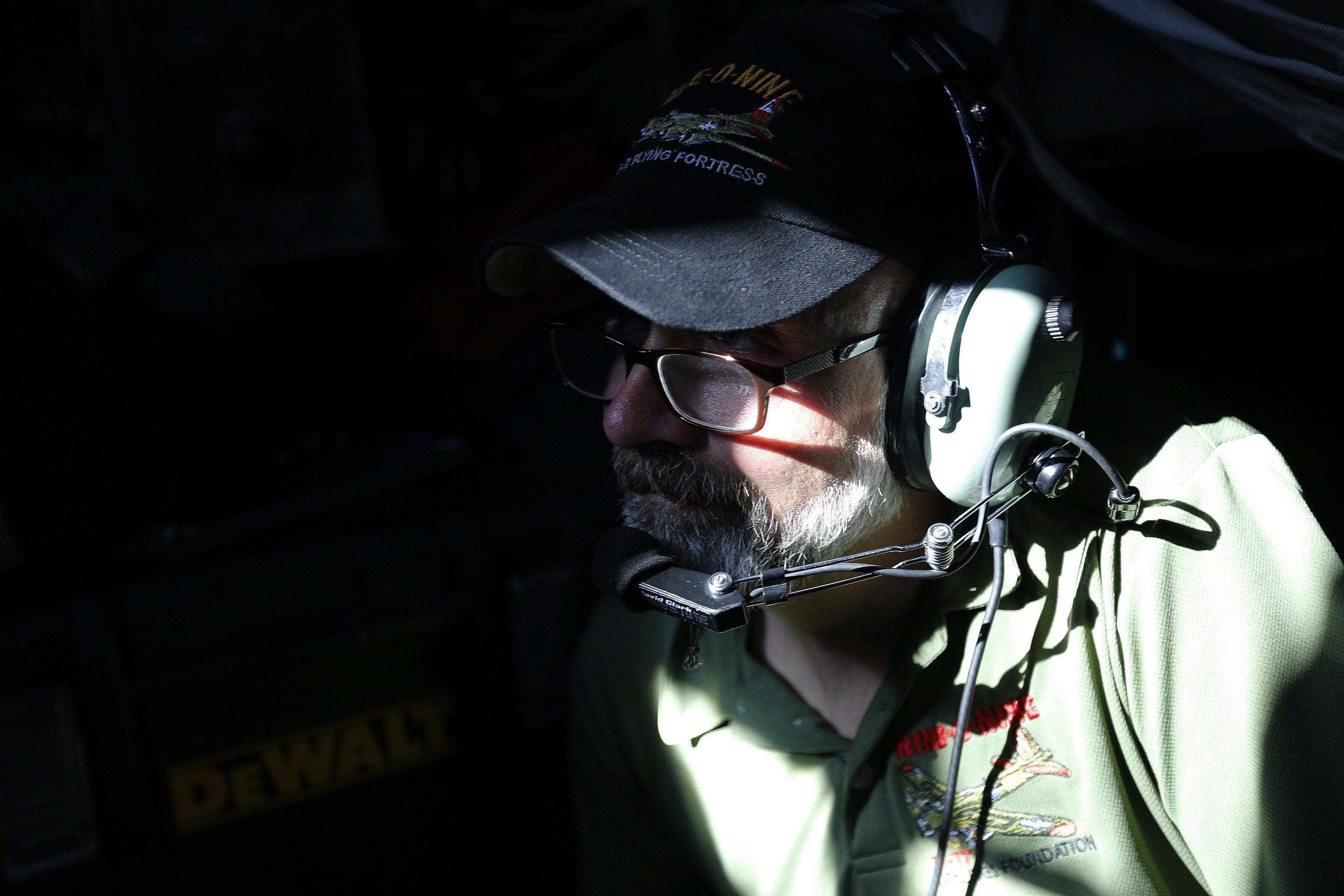 Flight engineer Stephen Arnold, of Seattle, sits in the cabin of the world's only flying B-24J Liberator as it flies over downtown Raleigh during the Wings of Freedom Tour at Raleigh-Durham International Airport, October 19, 2017. Hosted by the Collings Foundation, Wings of Freedom visits more than 100 cities a year to show off working pieces of American war history as well as to educate people about the veterans of WWII. The tour will be in Burlington, NC until 12 pm on Oct. 25 and then move to Statesville, NC through Oct. 27. (Eamon Queeney / North State Journal)