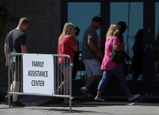People enter the Family Assistance Center set up in the Las Vegas Convention Center, following the mass shooting at the Route 91 music festival in Las Vegas, Nevada, U.S., October 2, 2017. REUTERS/Mike Blake