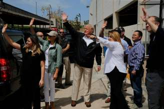 U.S. President Donald Trump and first lady Melania Trump arrive at a distribution center while surveying hurricane damage in San Juan, Puerto Rico, U.S., October 3, 2017. REUTERS/Jonathan Ernst
