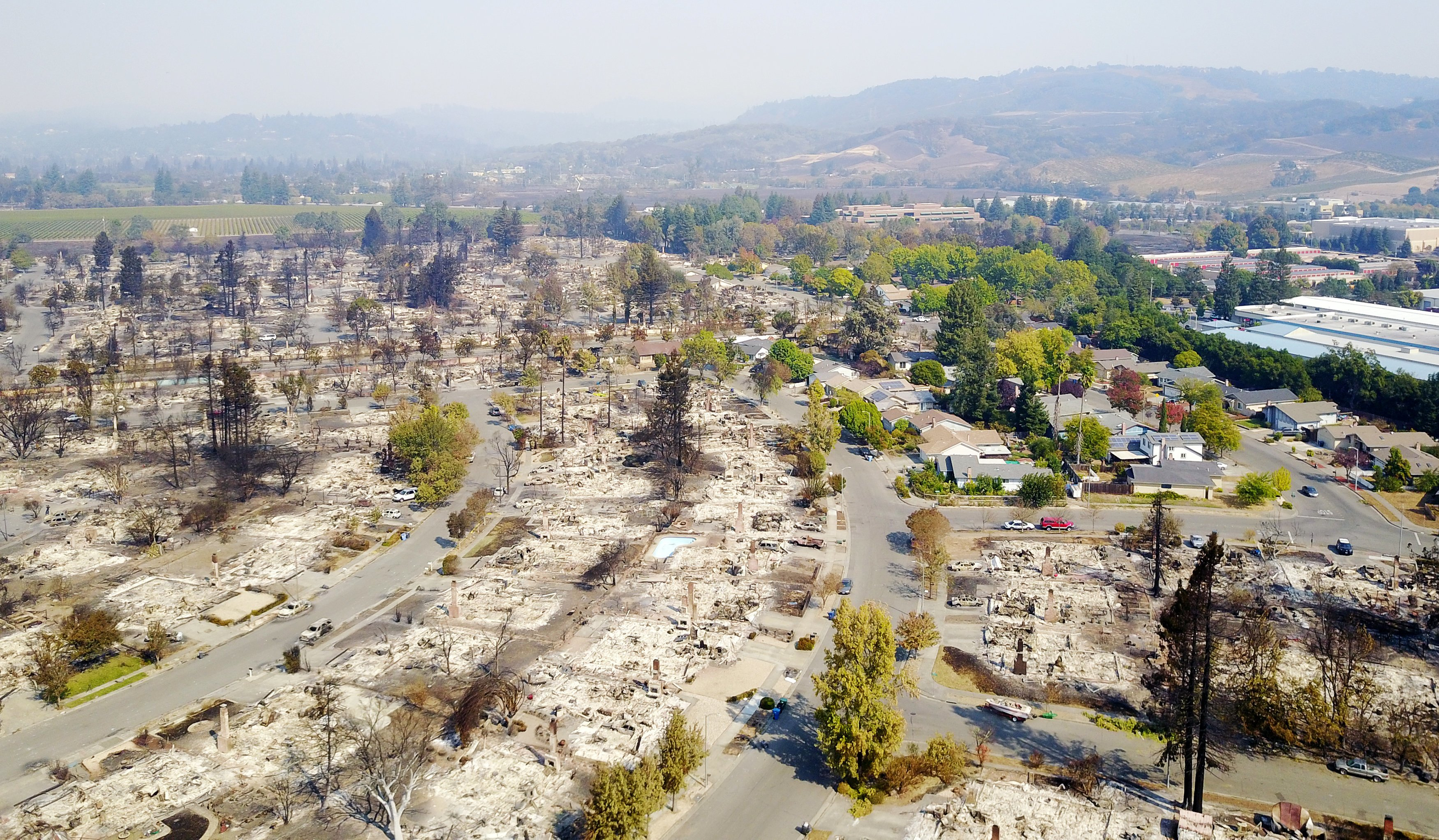 An aerial shows damage caused by wildfires in Santa Rosa, California, U.S October 11, 2017. Picture taken October 11, 2017. REUTERS/DroneBase