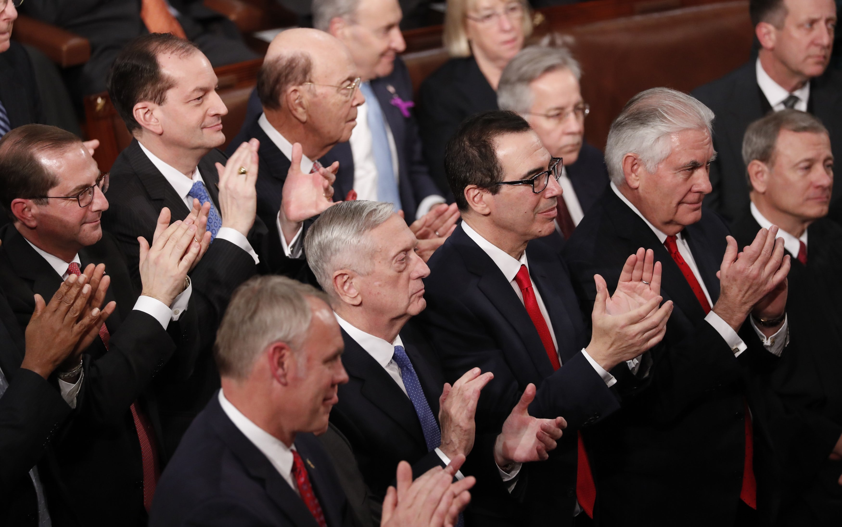 Cabinet members applaud as U.S. President Trump delivers his State of the Union address in Washington