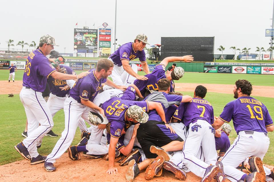ECU's players celebrate their AAC tournament championship victory against UConn on Friday