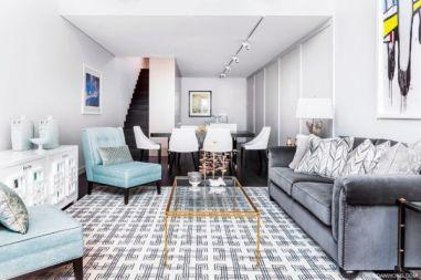 basement living room geometric rug