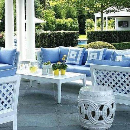 m white outdoor sofa and chairs with blue cushions