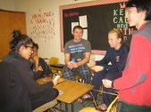 Seniors Alina Taher, Gautam Ravichandran, Nick Leffler, Amanda Poroch, and Daniel Muehring play cards for a break from work