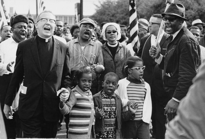 The Selma to Montgomery marchers arrive in Montgomery. At center are Martin Luther and Coretta Scott King, with Ralph Abernathy's three children.