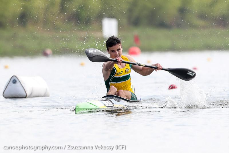 Paracanoeist Dylan Littlehales sprinting in Australian team singlet