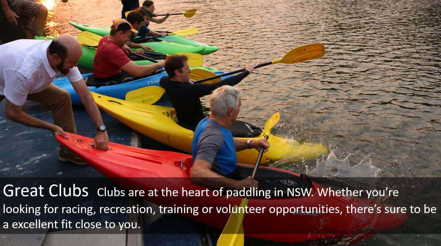 Paddlers dropping off pontoon in playboats, with text on Great Clubs
