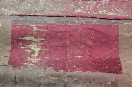Proper left head curtain from Spangled bed- Satin patch adhered upside down. Same satin as arabesque design with the metal thread removed leaving design visible ©National Trust/Textile Conservation Studio.