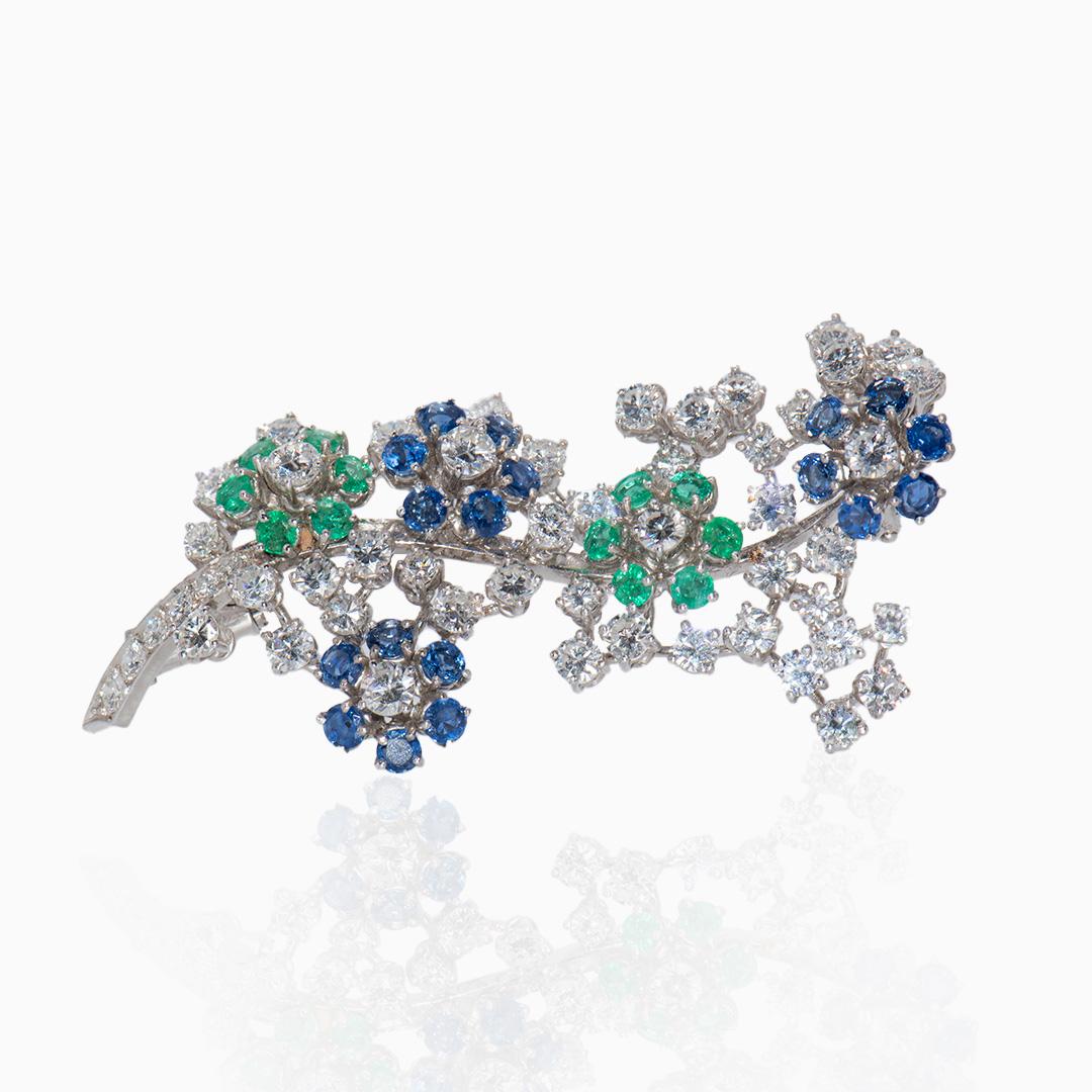 Broche Oro Blanco Zafiros, Esmeraldas y Diamantes en forma de Ramillete