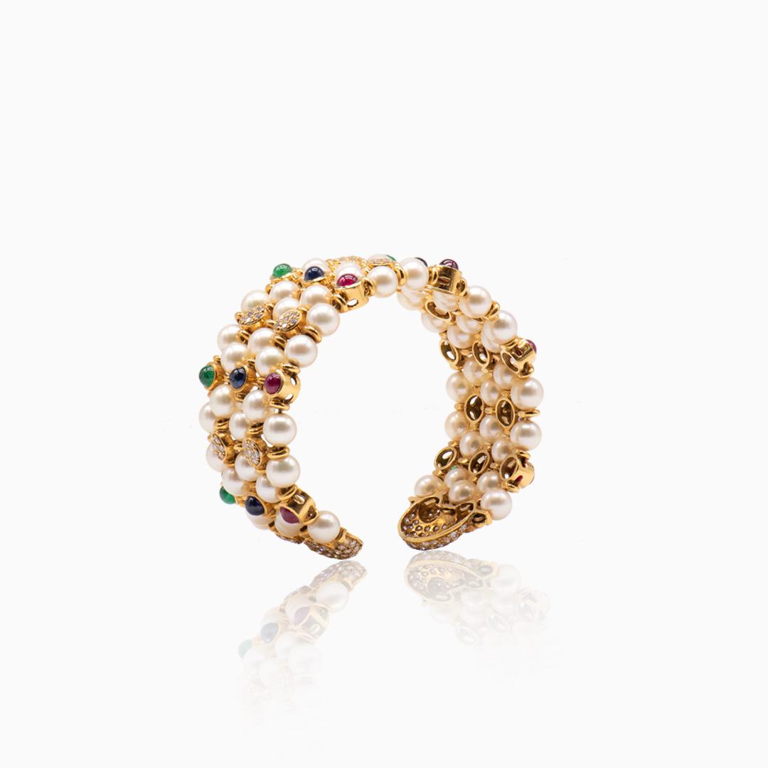 Pulsera de Oro Esmeraldas Rubíes Zafiros Perlas y Diamantes