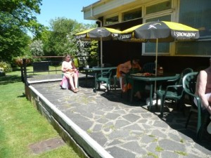 The sun-trap veranda at Fiveacres Naturist club