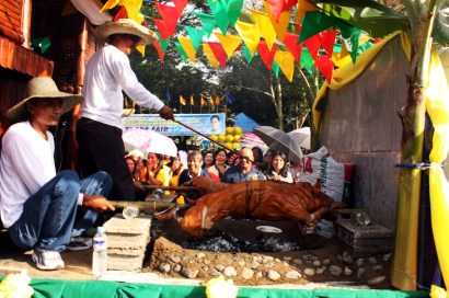 a barrio folks demonstrate on how to roast pig. a food that you can't do without during any kind of celebration. Ist Cry of Nueva Ecija 116th celebration every 2nd of September