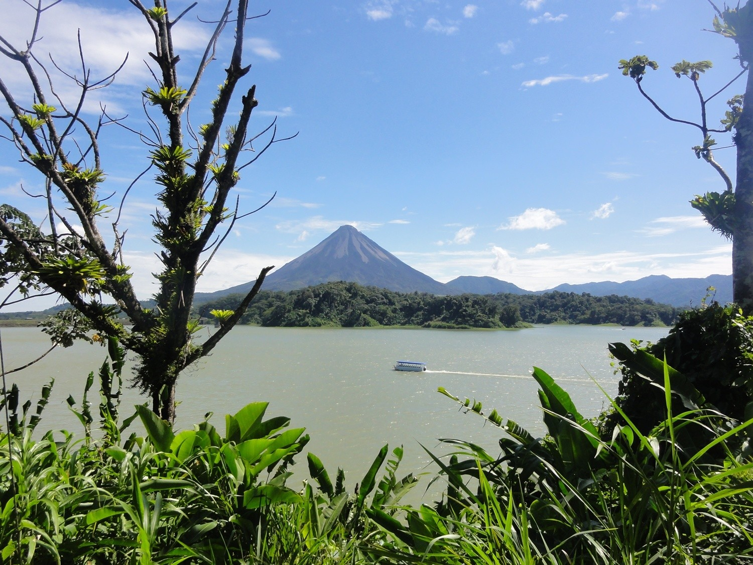 Boat in front of Arenal Volcano