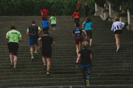 A group of runners run up the steps of the Museu Nacional d'Art de Catalunya in Barcelona. While solo runners are a more popular sight, it is not uncommon to see groups like this one running together. Photo by Clara Cutbill.