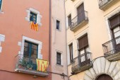 Two different types of the Estelada flag hang from a building in the city of Girona in northern Spain.