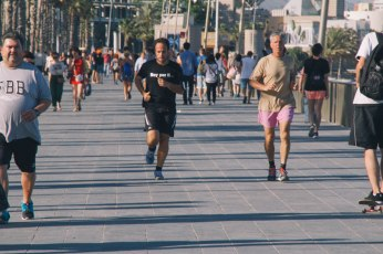 Men run near the beach on the Barceloneta boardwalk. Like in the United States, running is one of the most popular ways to workout in Spain. Photo by Clara Cutbill.