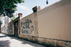 On this wall surrounding Jardins d'Emma de Barcelona, a few blocks from his apartment, there used to be graffiti painted alongside Tort's murals. When the city council came to repaint the wall, they painted over everything except his work. Tort said they were able to recognize the difference between his murals and other graffiti.