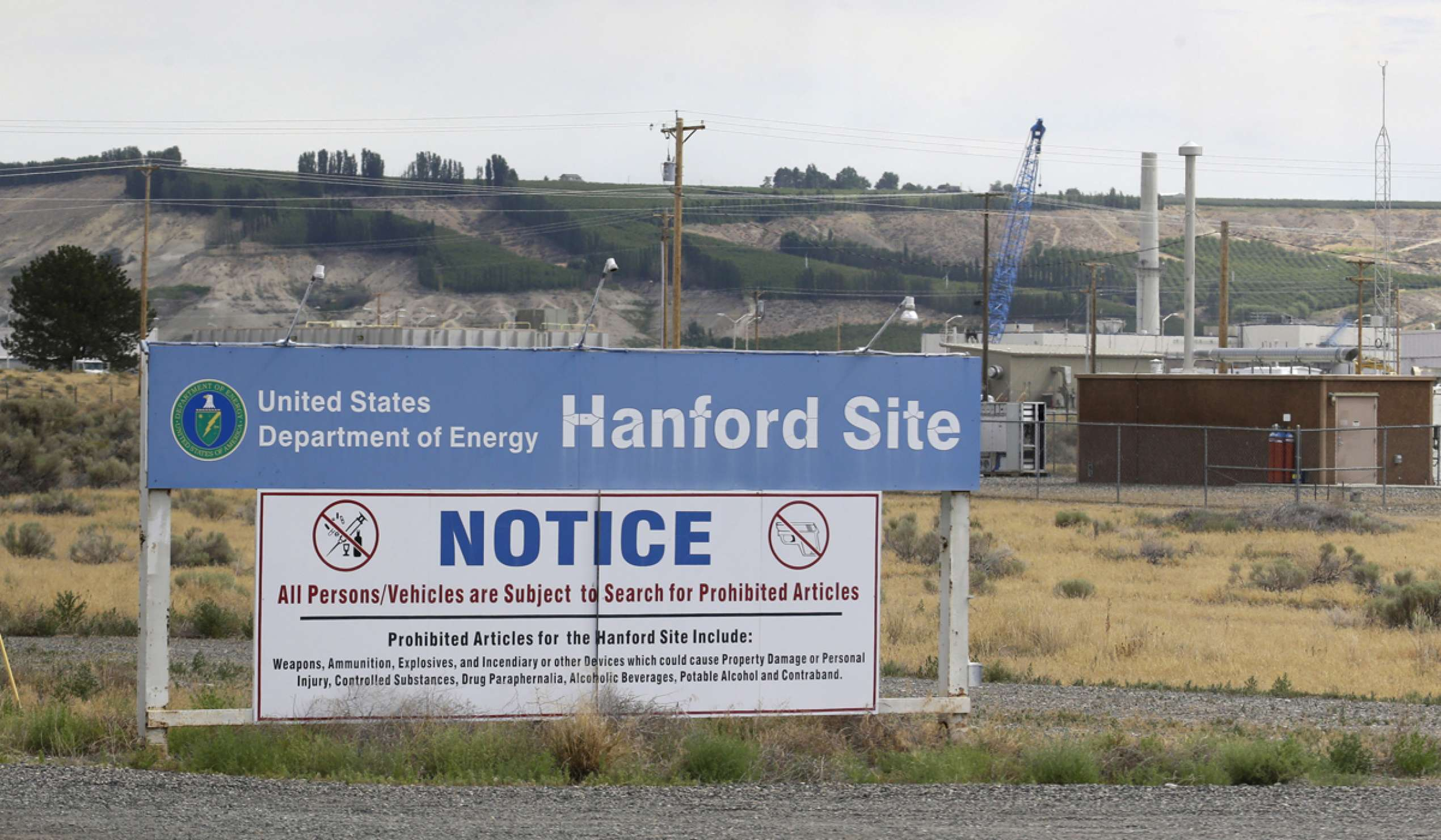 A sign informs visitors of prohibited items on the Hanford Nuclear Reservation near Richland, Washington in July 2014. from Ted S. Warren/AP