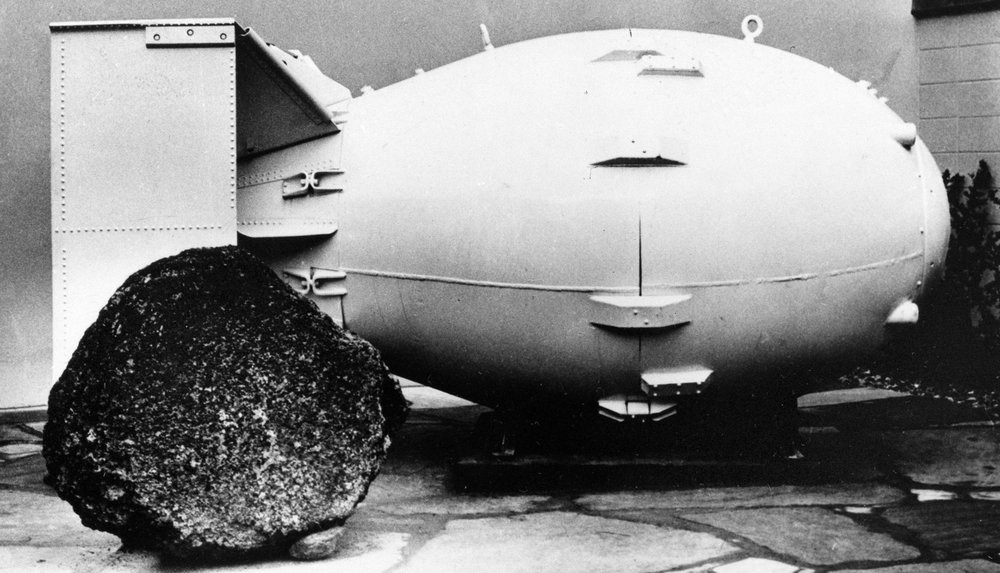 "FILE - This Oct. 15, 1965, file photo shows a ""Fat Man"" nuclear bomb of the type tested at Trinity Site, N.M, and dropped on Nagasaki, Japan in 1945, on view for the public at the Los Alamos Scientific Laboratory Museum. A compensation program for those exposed to radiation from years of nuclear weapons testing and uranium mining would be expanded under legislation that seeks to address fallout across the western United States, Guam and the Northern Mariana Islands. (AP Photo, File)"