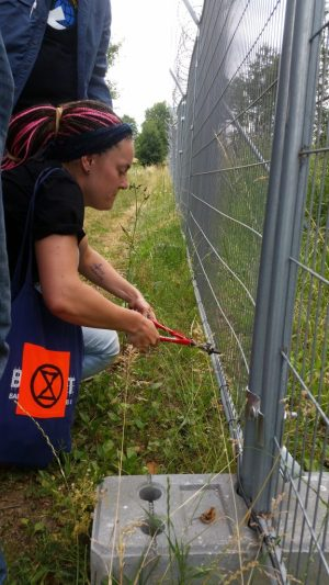 "International peace activists cut through new ""security"" fencing meant to keep nuclear weapons under control."