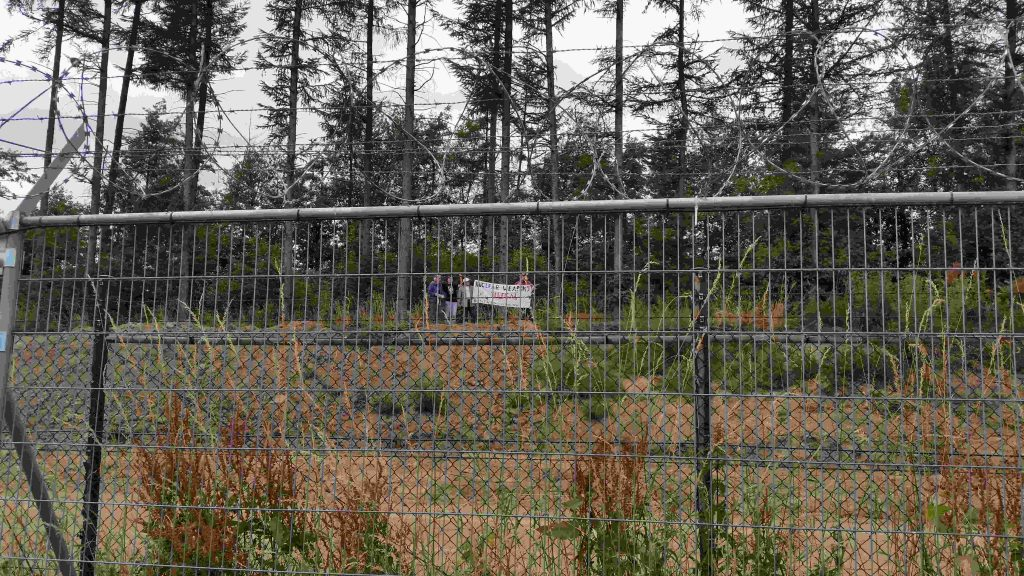 Four international peace activists reached far beyond the two security gates surrounding Buechel Air Force Base where US nuclear weapons are housed.