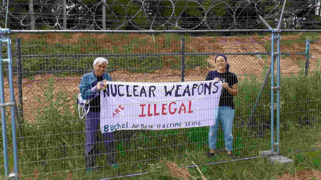 The banner of Susan Crane and Magriet Bos of the Treaty Enforcment Action activists explains why they have entered the Buechel Air Force Base.