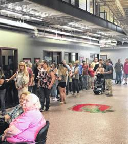 A small portion of the crowd which lined up and waited hours Tuesday in the OSU Endeavor Center in Piketon.