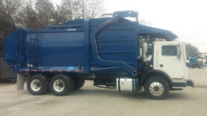 Passenger Side View: Front Loader Garbage Truck Mack MRU613 with Wayne Titan Body