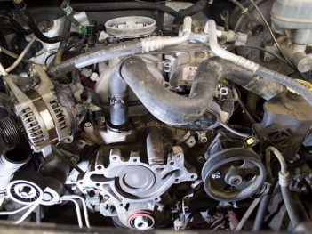 Auto Mechanic Water Pump Replacement