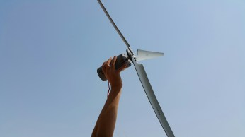 PVC pipe, a scrap motor and voila! You have a windmill made by Habib University brains
