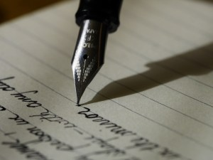 A fountain pen writing something out. Maybe they're binding and non-binding moving quotes?