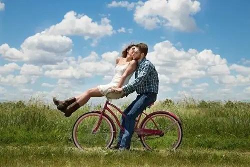 pair on bicycle