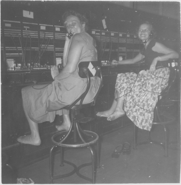 August 1950, Germ working as an operator for Southern Bell. Note the bare feet!