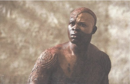 "Djimon Hounsou in the Julie Taymor film adaptation of ""The Tempest"" (2010), starring Helen Mirren as ""Prospera."" Hounsou also played the leader of the slave mutiny in Steven Spielberg's 1997 film ""Amistad."""