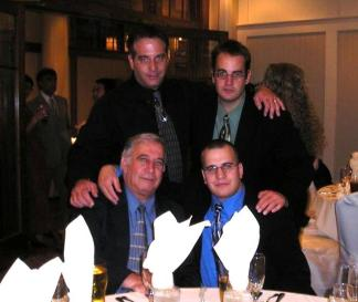 With his three sons.