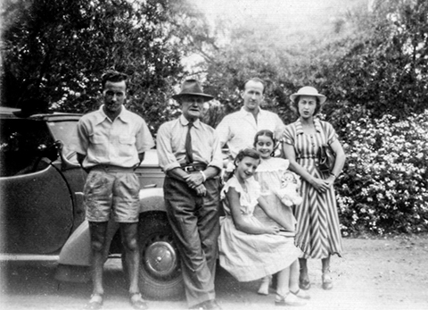 Thomas family and Vauxhall Tourer c1951