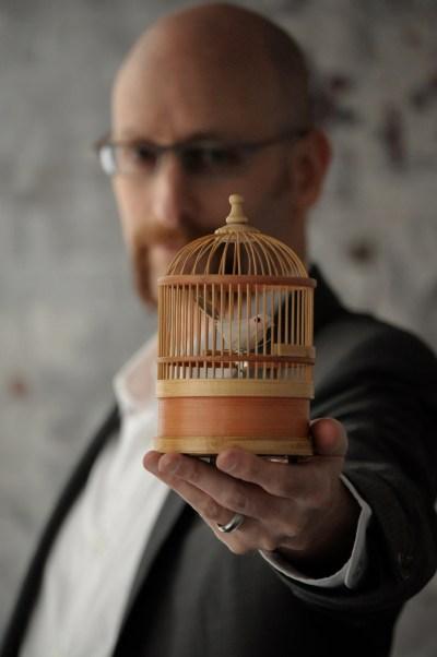 David Smooke with a tiny birdcage