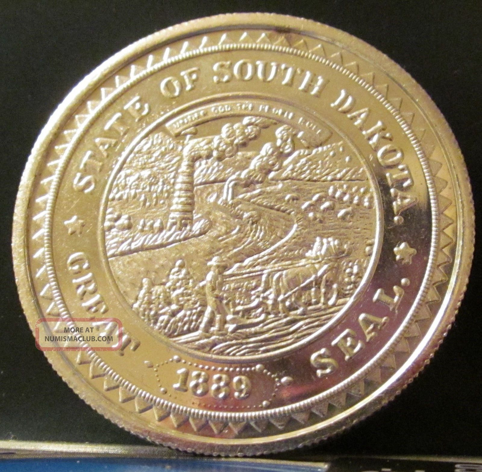 1987 one troy ounce silver south dakota round coin 999, 999 fine silver coin value