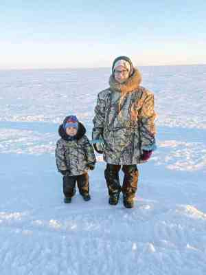 0309Ina Pikuyak<br /> Ina Pikuyak<br /> Hall Beach, living in Iglulik<br /> It's suppose to be father son parka, but I used the parka that I made more my spouse.