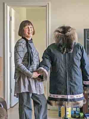 Bessie Beasely<br /> Cambridge Bay<br /> 1510Bessie Beasely_st2.jpg<br /> The artist with an adult sized coat.