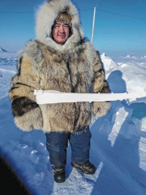 Lynn Emiktowt Arviat  1510Lynn Emiktowt_st1-3.jpg Nuatii Ishalook modelling the coat, I Lynn Emiktowt, softened and stretched the skins for, while his mom Maggie Manik sewed it - I helped a little with sewing.