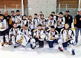 Spring Festival on Ice Tier 1 champion Rankin Rock peewee A team are, back row from left, Steve Sayles (coach), Dave Wiseman (coach) Luke Siksik, Gregory Wiseman, Liam Tattuinee, Darren Jr. Ikakhik, Preston Kaludjak, Seth Hamilton, Kadin Eetuk, Guili Issakiark, Kalluk Burton, Payton Kabluitok, Simon Wiseman (asstant coach), and, front from left, Michelle Okpatauyak, Ben Kusugak, Kylan Saviakjuk, Inuk Kowmuk, Ben Tulugak and Mia Autut in Edmonton, Alta., on March 31, 2019. Photo courtesy Nangmalik Wiseman