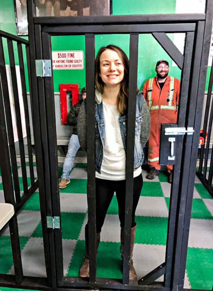 Christine Wilson and Andrew Quackenbush have time to reflect on their outlaw ways while locked-up at the arena jail during the Jail 'N' Bail fundraiser for the Rankin Rock novice team travelling to a Winnipeg tournament in Rankin Inlet on April 5, 2019. Photo courtesy of Mark Wyatt