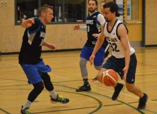 Nathaniel Cziranka-Crooks of Cambridge Bay looks to get past the guard of Yellowknife's Simon Markowski during the men's final of the Arctic Shoot-Out basketball tournament in Yellowknife on May 12. James McCarthy/NNSL photo