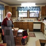 Rev. Mother tackles unpacking the kitchen.