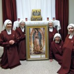 Handmaids treasure their time with this precious image of Our Lady.