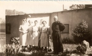 Father Gerald, still in his Holy Cross habit, with the very first Handmaids in 1947.