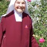 Sister, an avid gardener, displays her favorite flowers, Roses.